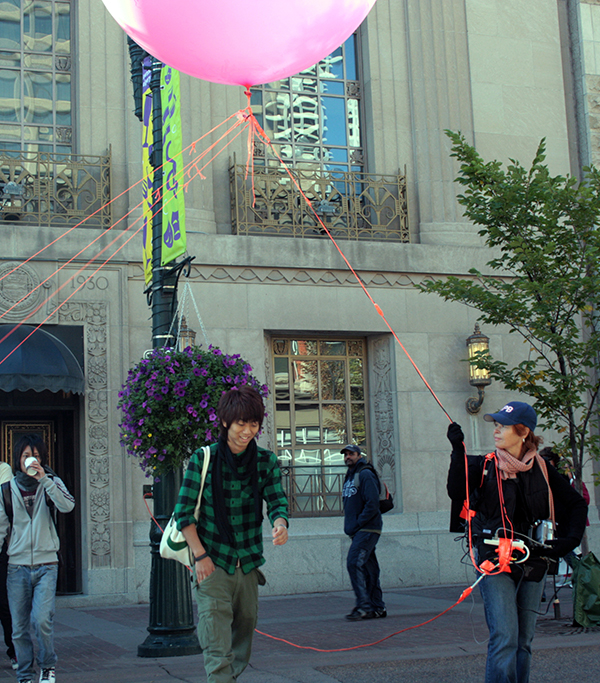 MPB EARTH (2008), Valerie LeBlanc and tourists, Stephen Avenue Mall, Calgary, AB.